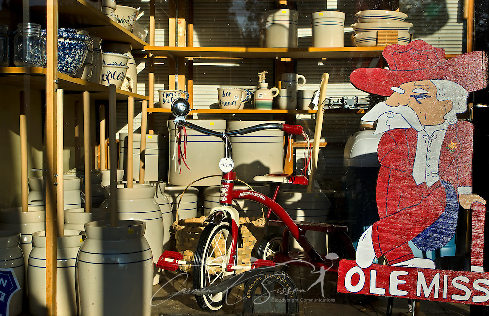 "Former Ole Miss mascot ""Colonel Reb"" oversees an eclectic assortment of butter churns, old-fashioned crockery, and a Radio Flyer tricycle at Booker Hardware & Cutlery Oct. 10, 2011 in Holly Springs, Miss. The store was established in 1937. (Photo by Carmen K. Sisson/Cloudybright)"