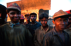 BANGLADESH CHITTAGONG MADHOM BIBIR HAT OCT00 - A group of labourers poses for a portrait during a rare break. Often the under-aged workers experience the greatest hardships, working up to 12 hours a day...Several thousand labourers work on one medium-sized (50,000 ton) ship for a period of around three months, until it is completely dismantled and taken apart. ..Since Bangladesh does not possess mineral resources such as iron ore, it works out more cost-efficient to employ a large army of day-labourers to recycle the scrapped ships rather than to import ore. On average, a labourer can expect to earn a little more than 1 US Dollar per day...jre/Photo by Jiri Rezac..© Jiri Rezac 2000..Contact: +44 (0) 7050 110 417.Mobile: +44 (0) 7801 337 683.Office: +44 (0) 20 8968 9635..Email: jiri@jirirezac.com.Web: www.jirirezac.com..© All images Jiri Rezac 2000 - All rights reserved.