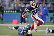 SEATTLE - NOVEMBER 28:  Wide receiver Eric Moulds #80 of the Buffalo Bills pulls away from a tackle by cornerback Marcus Trufant #23 of the Seattle Seahawks at Qwest Field on November 28, 2004 in Seattle, Washington. The Bills defeated the Seahawks 38-9. ©Paul Anthony Spinelli *** Local Caption *** Eric Moulds;Marcus Trufant
