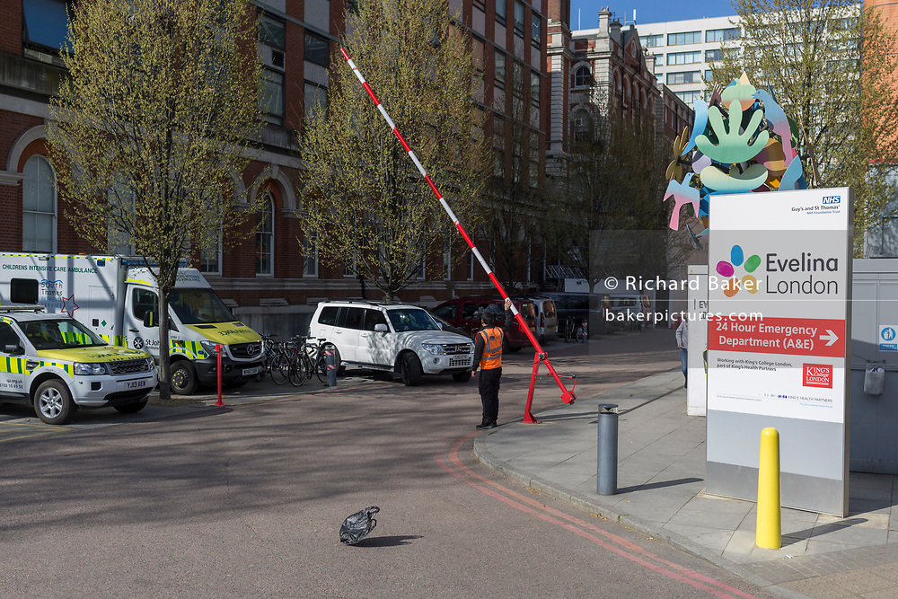 A security barrier is raised as a plastic bag lifts in a breeze outside Guy's and St. Thomas' hospital, on 25th March 2019, in London, England.