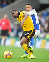 Football - 2018 / 2019 Premier League - Brighton & Hove Albion vs. Wolverhampton Wanderers<br /> <br /> Anthony Knockaert of Brighton pulls back Ivan Cavaleiro of Wolves, at The Amex.<br /> <br /> COLORSPORT/ANDREW COWIE