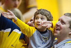 Feb 11, 2017; Morgantown, WV, USA; A young West Virginia Mountaineers fan waves to the crowd prior to the game against the Kansas State Wildcats at WVU Coliseum. Mandatory Credit: Ben Queen-USA TODAY Sports