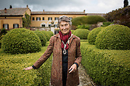 Italy, La Foce - Benedetta Origo (daughter of Iris Origo) portrayed in the gardens of La foce property. Mrs Origo is the owner of La Foce.<br /> Ph. Roberto Salomone