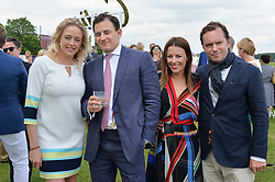Left to right, LADY ALEXANDRA SPENCER-CHURCHILL, ED GRUNDY, GREGOR & JULIET ANGUS at the Cartier Queen's Cup Polo final at Guard's Polo Club, Smiths Lawn, Windsor Great Park, Egham, Surrey on 14th June 2015