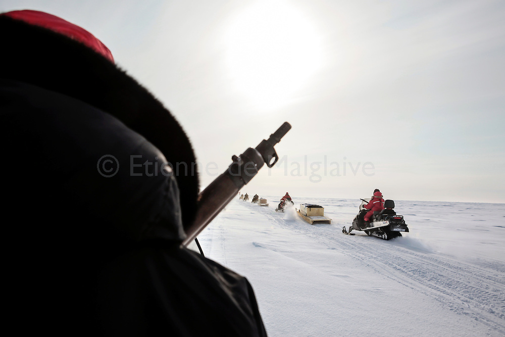 Canadian Rangers patrol rides snowmobiles for a shooting drill next to their camp in Baring Bay on Devon Island, Nunavut, during Nunalivut 2012 sovereignty exercise in arctic Canada. 20 April 2012. At this time they were equipped with antediluvian Lee Enfield rifles that were later replaced with more modern weaponry. <br /> Rangers are army units that mix local volunteers, here Inuits, and professional military acting as eyes and ears in the most remote areas of northern Canada.