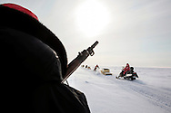 Canadian Rangers patrol rides snowmobiles for a shooting drill next to their camp in Baring Bay on Devon Island, Nunavut, during Nunalivut 2012 sovereignty exercise in arctic Canada. 20 April 2012. At this time they were equipped with antediluvian Lee Enfield rifles that were later replaced with more modern weaponry. <br />