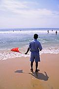 man keeping watch along shoreline, south india