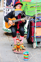 Spain, Barcelona. La Rambla is a street in central Barcelona. Street performance artist.
