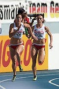 (R) Marika Popowicz and (L) Weronika Wedler both from Poland compete in women's relay 4x100 meters qualification during the 14th IAAF World Athletics Championships at the Luzhniki stadium in Moscow on August 18, 2013.<br /> <br /> Russian Federation, Moscow, August 18, 2013<br /> <br /> Picture also available in RAW (NEF) or TIFF format on special request.<br /> <br /> For editorial use only. Any commercial or promotional use requires permission.<br /> <br /> Mandatory credit:<br /> Photo by &copy; Adam Nurkiewicz / Mediasport