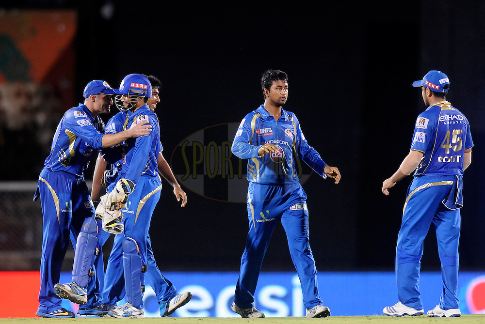 Pragyan Ohja of the Mumbai Indians celebrates the wicket of Brendon McCullum of The Chennai Superkings during the eliminator match of the Pepsi Indian Premier League Season 2014 between the Chennai Superkings and the Mumbai Indians held at the Brabourne Stadium, Mumbai, India on the 28th May  2014<br /> <br /> Photo by Pal PIllai / IPL / SPORTZPICS<br /> <br /> <br /> <br /> Image use subject to terms and conditions which can be found here:  http://sportzpics.photoshelter.com/gallery/Pepsi-IPL-Image-terms-and-conditions/G00004VW1IVJ.gB0/C0000TScjhBM6ikg