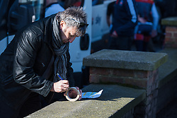 Making the notes of the key points of the race - Le Samyn des Dames 2016, a 113km road race from Quaregnon to Dour, on March 2, 2016 in Hainaut, Belgium.