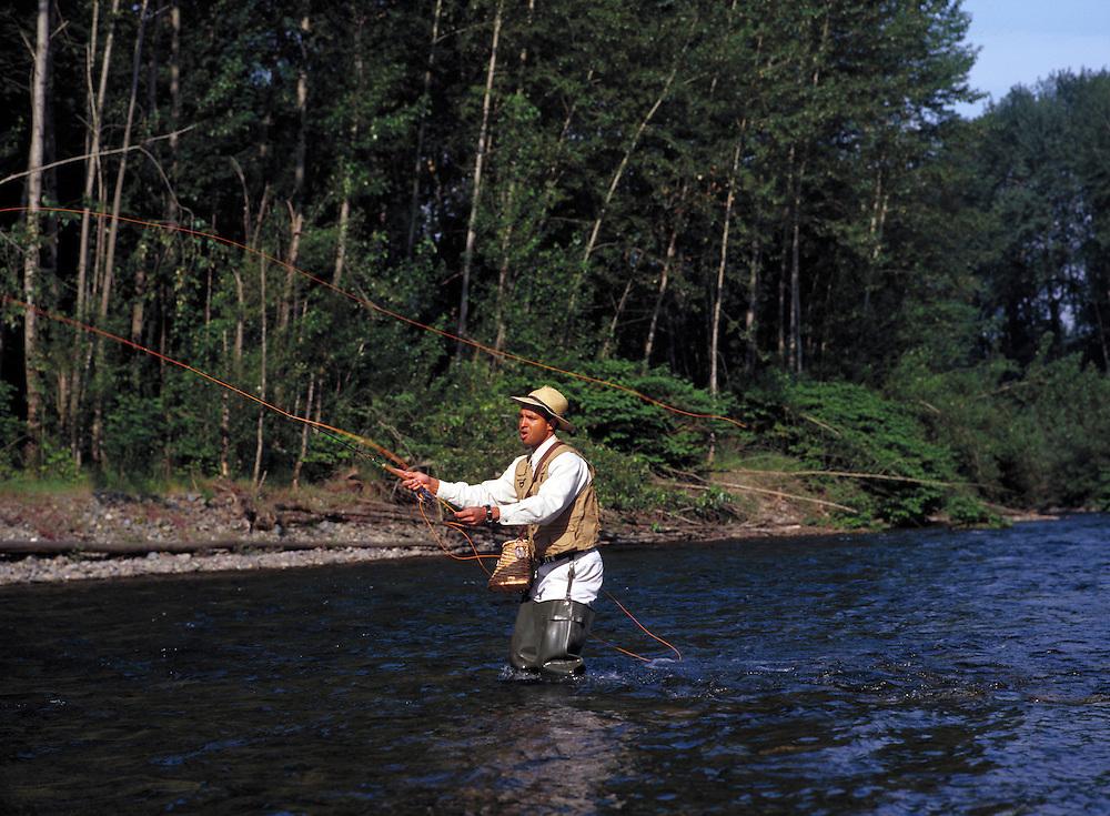 Man fly fishing in Snoqualamie River, Washington State.