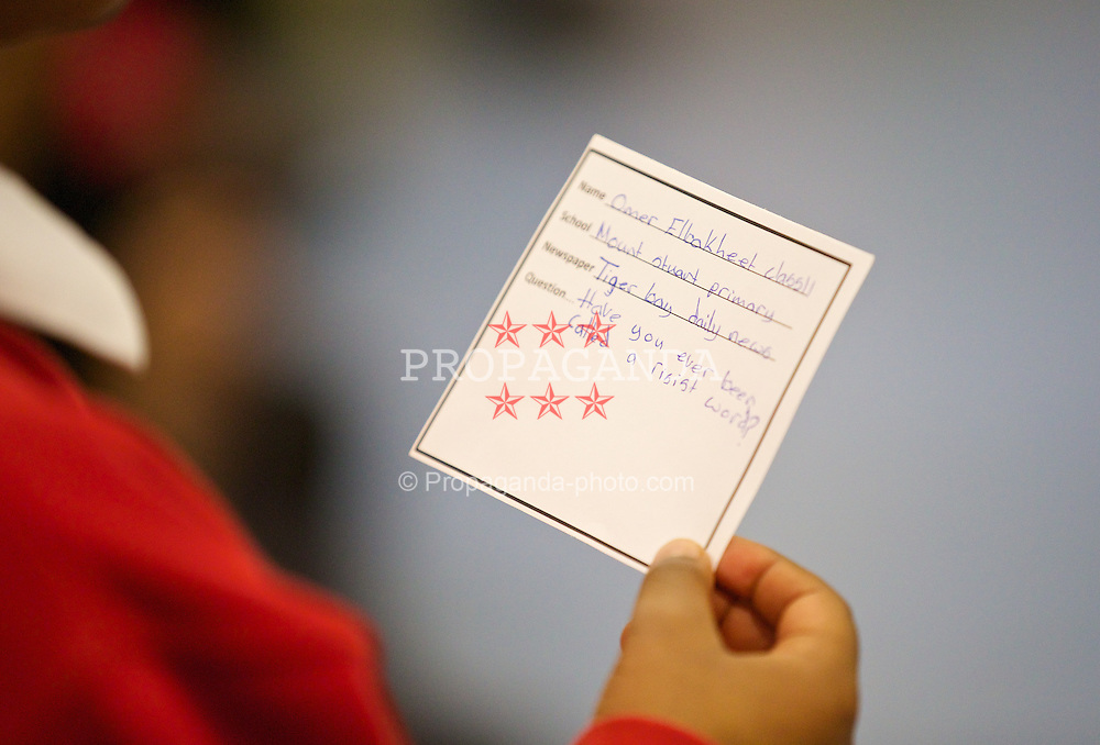 NEWPORT, WALES - Tuesday, October 7, 2014: A pupils asks a question to Wales platers during a visit to Mount Stuart School for a Show Racism the Red Card promotion ahead of the UEFA Euro 2016 qualifying match against Bosnia and Herzegovina. (Pic by David Rawcliffe/Propaganda)