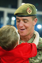 © Licensed to London News Pictures . 25/04/2013. Catterick Barracks , North Yorkshire , UK . Stephen Rumble (Dad , 26) hugs son Stephen Rumble Jnr (two) (from Liverpool) . Soldiers from the 1st Battalion , the Duke of Lancaster's Regiment (1 Lancs) arrive at Catterick Barracks to be greeted by their families this evening (Thursday 25th April), following a six month tour in Lashkar Gah , Helmand Province , Afghanistan . With the UK combat mission due to complete by the end of 2014 , this is likely to be the last deployment by 1 Lancs in Afghanistan , the British Army reports . Photo credit : Joel Goodman/LNP