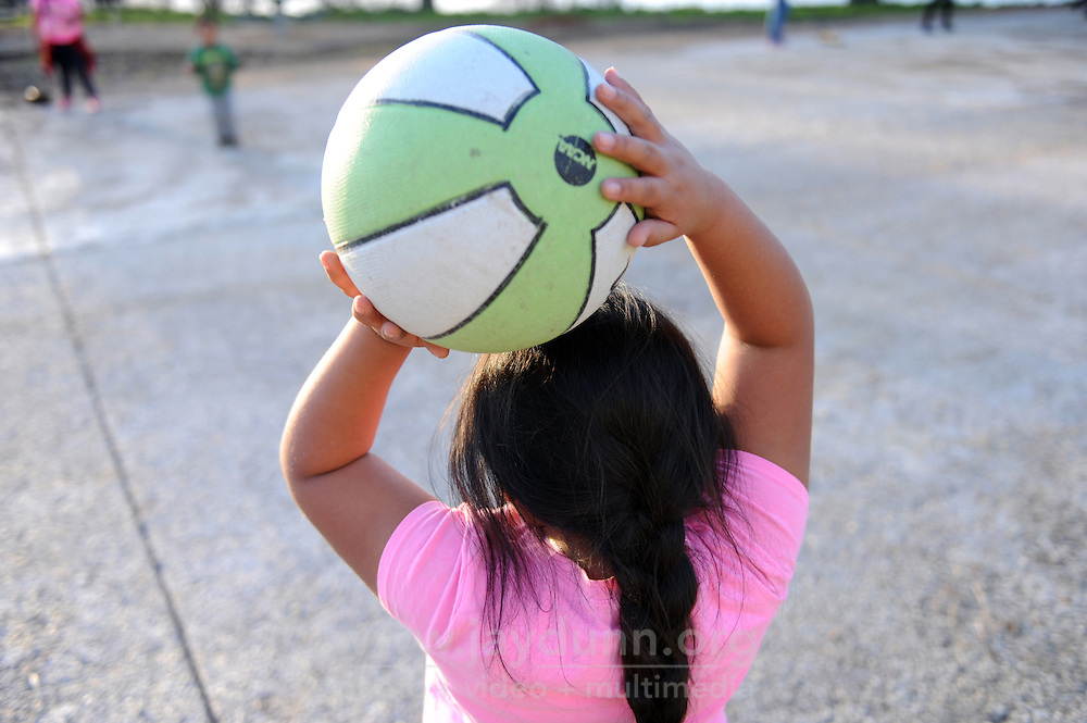 A girl holds a basketball over her head on Tuesday, February 2nd, 2016 at the nearly-completed Acosta Plaza Recreation Area in east Salinas, CA.