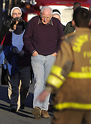 George Hochsprung, center, leaves a staging area for family after learning his wife, Sandy Hook Elementary School principal Dawn Lafferty Hochsprung, was one of 26 people killed in a shooting at the school in Newtown, Conn., Friday, Dec. 14, 2012. (AP Photo/Jessica Hill)