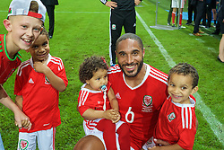 LILLE, FRANCE - Friday, July 1, 2016: Wales' captain Ashley Williams celebrates with his children after the 3-1 victory over Belgium during the UEFA Euro 2016 Championship Quarter-Final match at the Stade Pierre Mauroy. (Pic by David Rawcliffe/Propaganda)