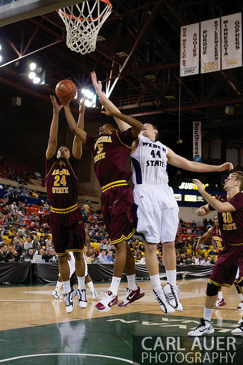 November 26th, 2010:  Anchorage, Alaska - Sun Devil's sophomore guard Trent Lockett (24) and freshman forward Kyle Cain (5) battle Weber State's freshman center Kyle Tresnak for a rebound in Arizona State's 59-58 victory over Weber State at the Great Alaska Shootout...