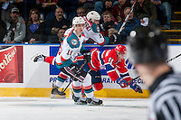 KELOWNA, CANADA - FEBRUARY 17: Jaret Anderson-Dolan #11 of the Spokane Chiefs is checked by Carsen Twarynski #18 behind Kole Lind #16 of the Kelowna Rockets on February 17, 2017 at Prospera Place in Kelowna, British Columbia, Canada.  (Photo by Marissa Baecker/Shoot the Breeze)  *** Local Caption ***