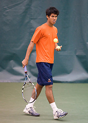 #1 nationally ranked Somdev Devvarman (Virginia) prepares to serve during the #1 doubles match.  The #1 nationally ranked men's doubles team of Somdev Devvarman and Trent Huey defeated #33 ranked Alex Cojanu/Keziel Juneau 8-6.    The #1 ranked Virginia Cavaliers men's tennis team faced the #43 ranked William and Mary Tribeat the Boyd Tinsley Courts at the Boars Head Inn in Charlottesville, VA on January 20, 2008.