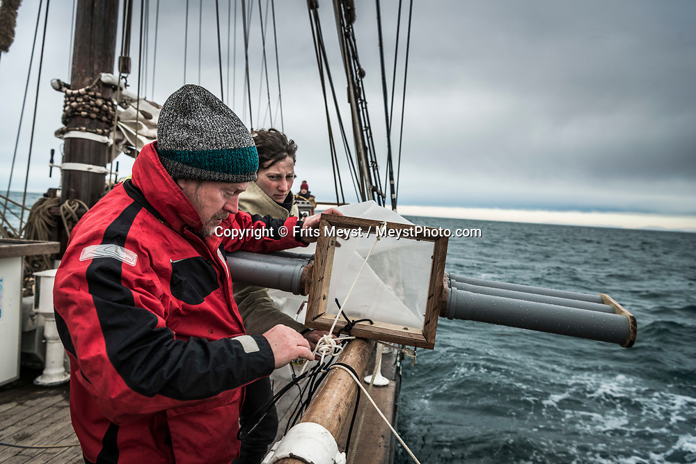 Iceland, April 2019. Torsten Geertz is from Denmark is the main micro plastics researcher on board. Trawling for microplastics with the so called Manta Trawl. With this device the scientists van trap plastic and count particles in the water.  Scientists, storytellers and industrial designers work together during the Ocean Missions Iceland scientific sailing expedition aboard Schooner Opal.  The organisation wants to inspire people to take direct action towards ocean conservation, by combining science and education with exploration and adventure. Photo by Frits Meyst / Meystphoto.com