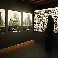 "VENICE, ITALY - JUNE 01:  A model poses in front of  Flavio Lucchini's works at the exhibition ""What Women Want (?)"" on June 1, 2011 in Venice, Italy. The exhibition addresses the controversiat theme of the burqa"