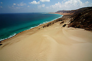 The big dunes of Archar, northern coast of Socotra, Yemen. Dormant and indecisive, the island of Socotra has floated for millions of years between Africa and the Arabian peninsula. Such isolation makes it the ideal sanctuary for vegetation that has endured since the Tertiary period (65-2 million years ago), and a peaceful refuge for a vibrant aboriginal culture, an island shrouded in mystery and dark secrets.