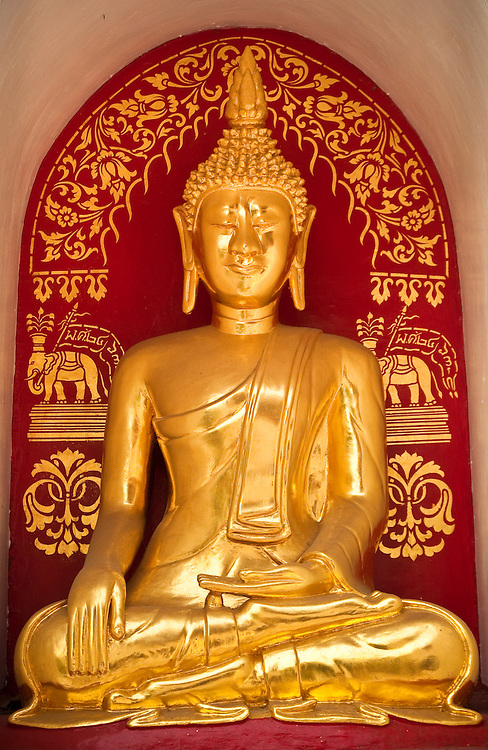 Golden Buddha statue at Wat Fon Soi Buddhist temple in Chiang Mai, Thailand.