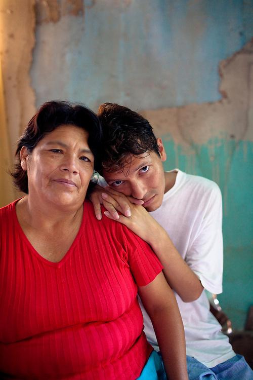 Luis Enrique Sanchez Munoz (27) and his mother, Fausta Feliciana Munoz Gonzales (53), pose for a portrait on Tuesday, Apr. 7, 2009 in Ventanilla, Peru.