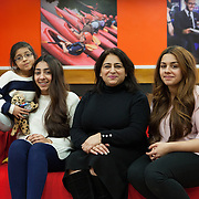 """Slough, Greater London, UK, January 28, 2015. YES, Youth Engagement Centre.<br /> Rani Bilkhu, founder of """"Jeena International"""", with her three daughters. Low value of girls, son-preference can still be found in the Indian community. The goals of Rani's charity are to raise awareness of sexuality and fight gender-selective abortions. In her own life, if she had listened to her aunt, Rani (then mother of two boys and two girls) would have terminated her fifth pregnancy once she heard it would be another girl (Sobha, her third girl, on the left of the picture)."""