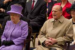 © Licensed to London News Pictures. 02/05/2012. Exeter, UK. Queen Elizabeth II and the Duke of Edinburgh watch a performance by Exeter College Students orchestra and choir. Photo credit : Ashley Hugo/LNP