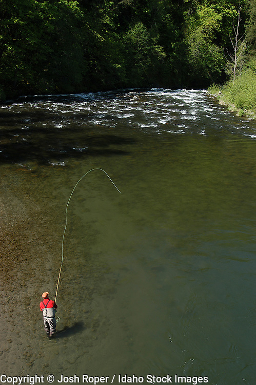 Aerial of Fly fisherman casting into a beautiful river for trout. Washington