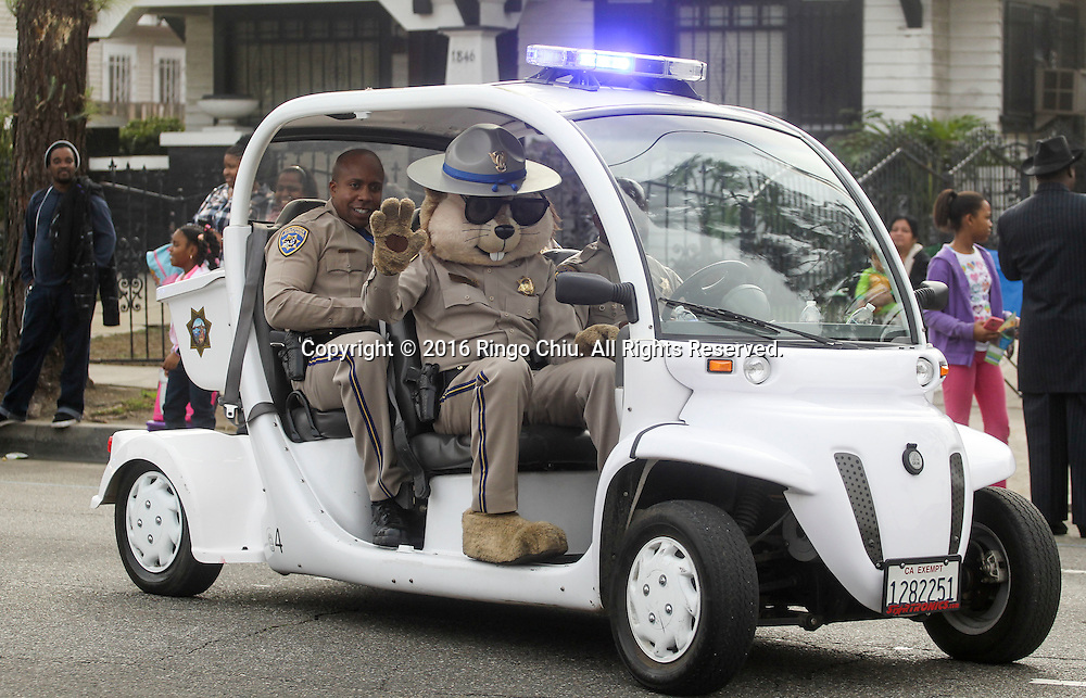 The California Highway Patrol mascot Chipper waves as the Martin Luther King Jr. parade makes it's way down Martin Luther King Blvd. in Los Angeles on Monday Jan. 18, 2016. The 31st annual Kingdom Day Parade honoring Martin Luther King Jr. was themed &quot;Our Work Is Not Yet Done&quot;(Photo by Ringo Chiu/PHOTOFORMULA.com)<br /> <br /> Usage Notes: This content is intended for editorial use only. For other uses, additional clearances may be required.
