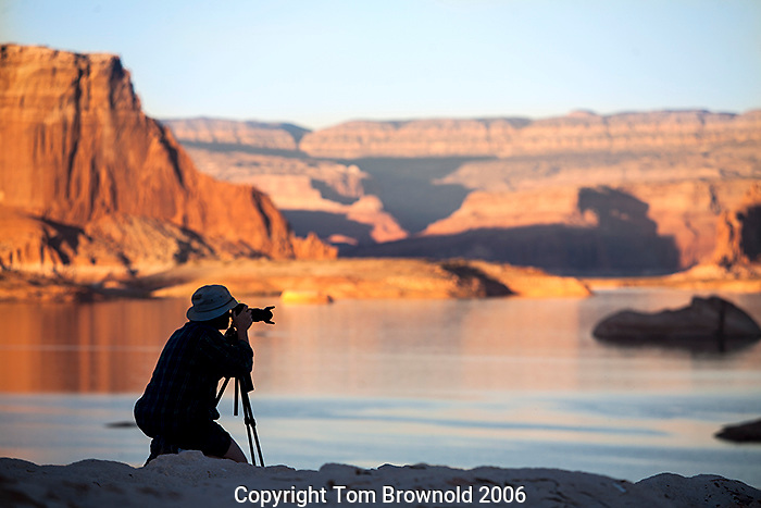 Photographer capturing the evening light and no wind on lake Powell