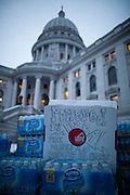 Ian's Pizza distributes pizzas and beverages donated to protestors at the State Capitol in Madison, WI, February 23, 2011.
