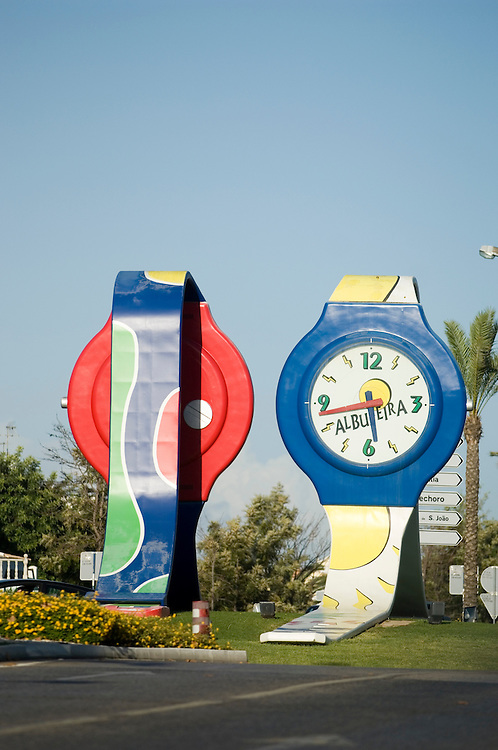 Giant watches on a roundabout in the tourist resort of Albufeira on the Algarve, Portugal