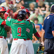 8/22/10 Aberdeen, MD: Mexico short stop Luis Urias (9) celebrate with his teammates after Urias blast a home-run in the bottom of the fourth inning at The Cal Ripken World Series in Aberdeen MD.  Credit: Saquan Stimpson/ Southcreek Global