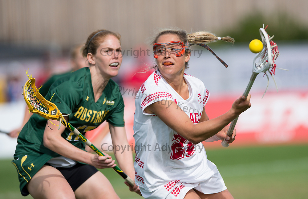 Australia's Rebecca Banyard challenges with Canada's Taylor Gait  during their semi-final at the 2017 FIL Rathbones Women's Lacrosse World Cup, at Surrey Sports Park, Guildford, Surrey, UK, 20th July 2017.
