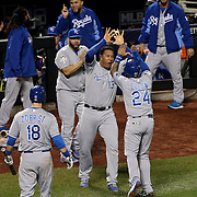 Salvador Perez, (center), Kansas City Royals, celebrates with Christian Colon as he scores a run in the twelfth inning during the New York Mets Vs Kansas City Royals, Game 5 of the MLB World Series at Citi Field, Queens, New York. USA. 1st November 2015. Photo Tim Clayton