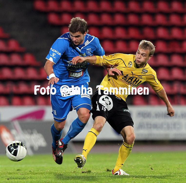 3.10.2010, Ratina, Tampere..Veikkausliiga 2010, Tampere United - Kuopion Palloseura..Aleksei Kangaskolkka (TamU) v Juho Nyk?nen (KuPS)..©Juha Tamminen.
