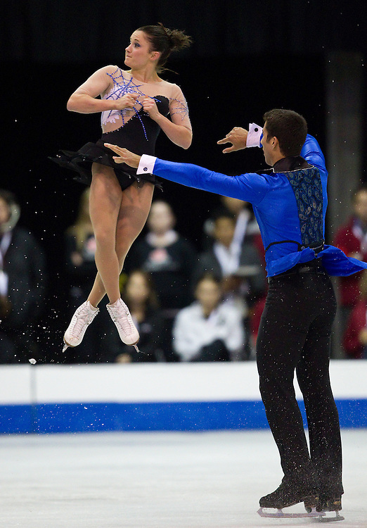 GJR -20111028- Mississauga, Ontario,Canada-  Paige Lawrence of Canada is thrown by her partner Rudi Swiegers during their short program at Skate Canada International, October 28, 2011.<br /> AFP PHOTO/Geoff Robins