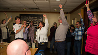 Andrew Hosmer shares the news with family and friends at the 405 after receiving the concession call from Peter Spanos.  (Karen Bobotas/for the Laconia Daily Sun)
