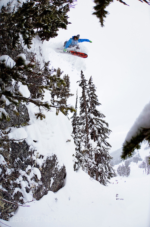 "Professional Snowboarder Dave Short launches through the trees on Blackcomb Mountain during the ""Deep Winter"" photo contest. The contest runs in Whistler, British Columbia every January."