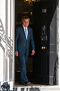 Republican presidential candidate Mitt Romney exits Number 10 Downing Street after meeting with UK Prime Minister David Cameron.