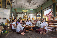 Family enjoying lunch in one of the shrines at Shwedagon Pagoda, Yangon.
