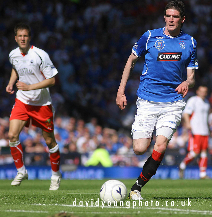 Kyle Lafferty races away from Gerard Aafjes during the Homecoming Scottish FA Cup Final between Falkirk and Rangers at Hampden Park (picture by David Young - 07765 252616)