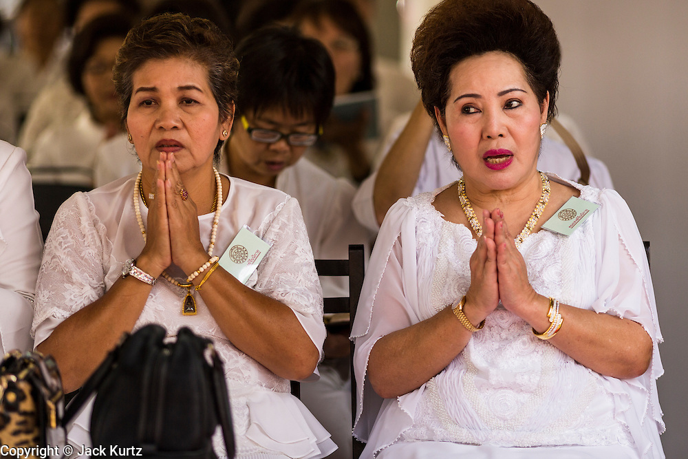 12 DECEMBER 2013 - BANGKOK, THAILAND:  Women pray for the Supreme Patriarch at Wat Bowon Niwet in Bangkok. Somdet Phra Nyanasamvara, who headed Thailand's order of Buddhist monks for more than two decades and was known as the Supreme Patriarch, died Oct. 24 at a hospital in Bangkok. He was 100. He was ordained as a Buddhist monk in 1933 and rose through the monastic ranks to become the Supreme Patriarch in 1989. He was the spiritual advisor to Bhumibol Adulyadej, the King of Thailand when the King served as monk in 1956. There is a 100 day mourning period for the Patriarch, the service Thursday, on the 50th day, included members of the Thai Royal Family. Although the Patriarch was a Theravada Buddhist, he was the Supreme Patriarch of all Buddhists in Thailand, including the Mahayana sect, which is based in Chinese Buddhism.    PHOTO BY JACK KURTZ