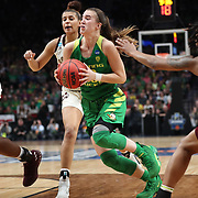 March 31, 2019; Portland, OR, USA; Oregon Ducks guard Sabrina Ionescu (20) dribbles between Mississippi State Bulldogs' defenders in the Elite Eight of the NCAA Women's Tournament at Moda Center.<br /> Photo by Jaime Valdez