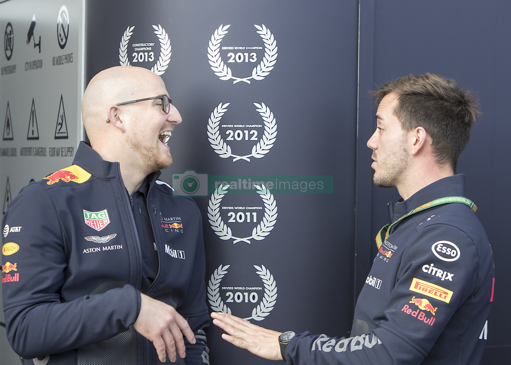 October 21, 2018 - Austin, USA - Members of the Aston Martin Red Bull Racing team share a laugh before the start of the Formula 1 U.S. Grand Prix at the Circuit of the Americas in Austin, Texas on Sunday, Oct. 21, 2018. (Credit Image: © Scott Coleman/ZUMA Wire)