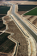 Aerial photograph of the California aqueduct, which carries water from north to south through the middle of the state. San Joaquin Valley. Agricultural land is seen on both sides of the aqueduct. Kern County, CaliforniaThe California State Water Project is the nation's largest state-built water and power development and conveyance system. Planned, designed, constructed and now operated and maintained by the California Department of Water Resources, this unique facility provides water supplies for 23 million Californians and 755,000 acres of irrigated farmland.